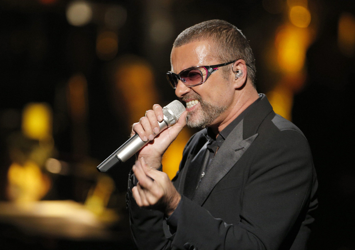 "FILE PHOTO DATED SUNDAY, SEPT. 9, 2012. FILE- British singer George Michael in concert to raise money for AIDS charity Sidaction, in Paris, France, in this file photo dated Sunday, Sept. 9, 2012. After a spell of making headlines for mishaps rather than music, Michael announced Monday Jan. 20, 2014, that his sixth solo album, ""Symphonica,"" is due for release March 17, 2014.(AP Photo/Francois Mori, FILE)"